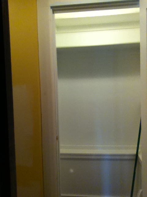 Closet shelving installed, before coat rod installed. First coat of paint complete, trim installed.