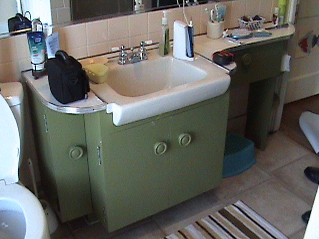 Bathroom Sink and Vanity Before Remodel