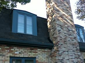 Re-Roofing home by Chimney