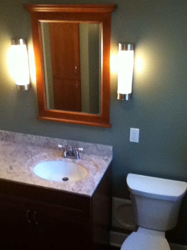 Remodeled Bathroom Vanity and Framed Mirror