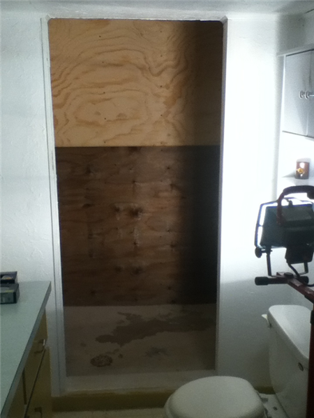 The plywood walls have been installed for a smooth surface for the TPO membrane.
