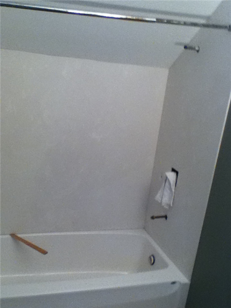 Installation of the marble walls for the shower.