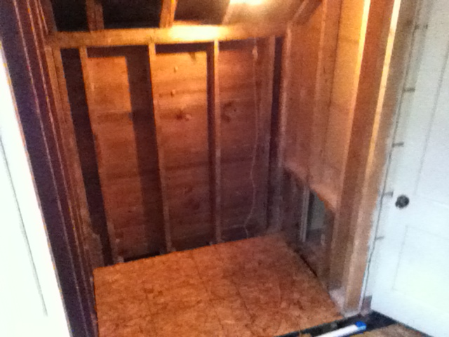 Shower area demolished to bare studs. Bulkhead above old shower removed to the pitch of the dormer to gain more head room for the new shower.