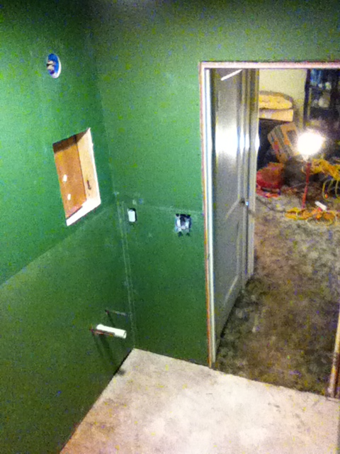 Moisture resistant drywall installed in the bathroom area. Medicine cabinet cut into the wall and rough plumbing and electrical cut out.