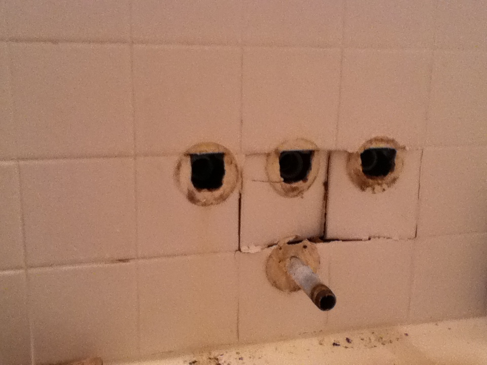 Damage to the ceramic tile walls within the shower. The tile crumbled when the shower valves were removed.