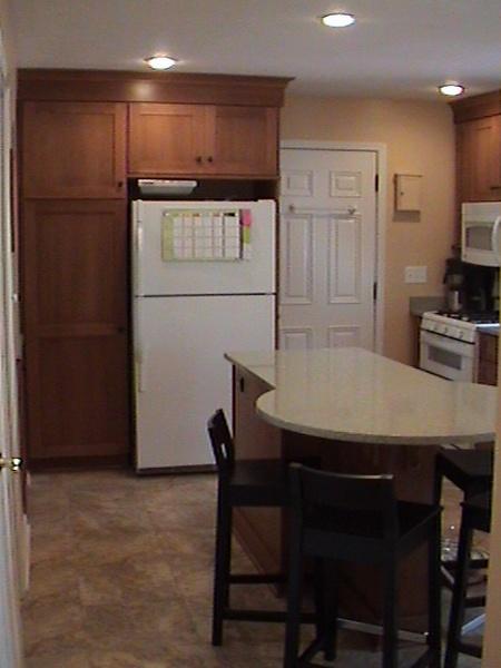 Newly located fridge and kitchen island.