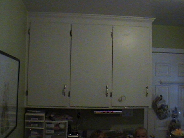 Wall cabinets where fridge was to be relocated.
