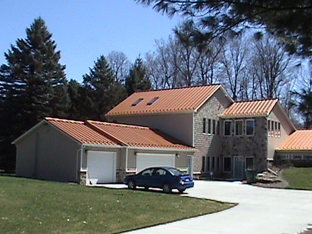 Garage and Front of home view of new metal roofing system.