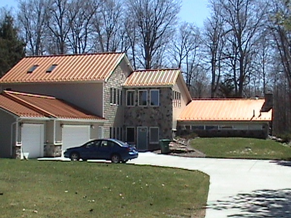Complete metal roofing system installed to replace shingled roof.