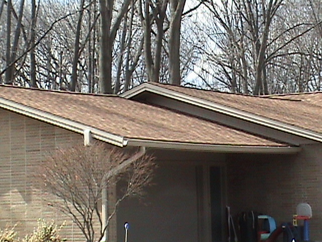 Detail of the new shingles installed of the garage of this home.