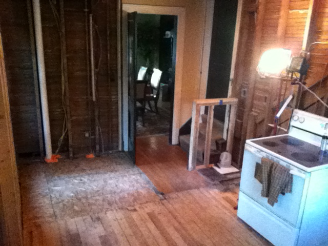 Half Bath, hallway, and kitchen demolished into one room.